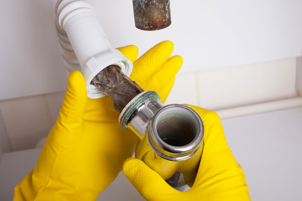 drain cleaning clogged pipe